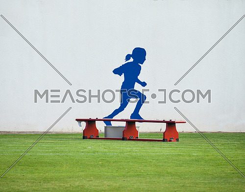 girl drawing running on a wall