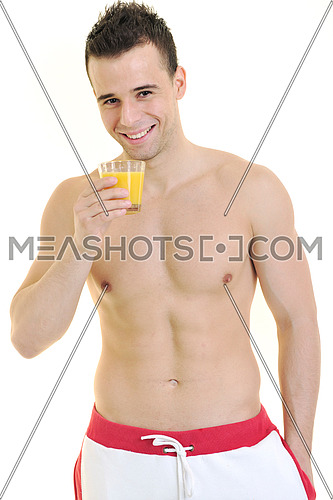 young fit man dringing orange juice isolated on white