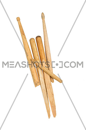 Devil horns rock fingers gesture sign of broken used wooden drumsticks isolated on white background