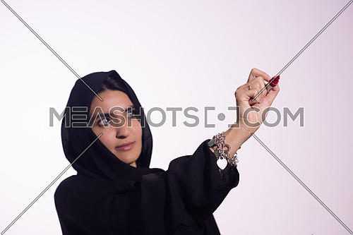 Arabian Middle eastern woman writing with marker on virtual screen isolated on white background