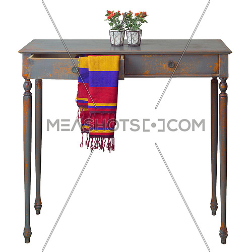 Vintage wooden table with two drawers painted in grey and orange with colorful scarf hanging down from one of the drawers, and desktop flower planter with red flowers and green leaves on the top