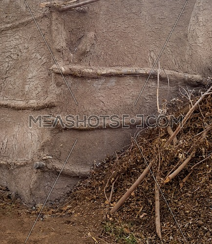 Traditional primitive straw clay wall at an Egyptian rural village