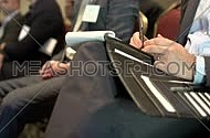Close shot for a businessman hand writhing notes while attending a business conference.