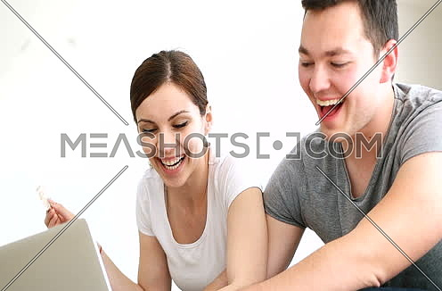 couple buying things for their home online
