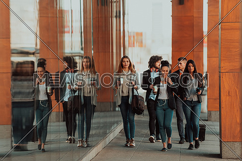 a group of diverse young businessmen on a break from work walk around the city, use smartphones, listen to music and have fun