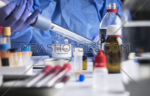 Specialist analyzes botulism Samples in laboratory, conceptual image