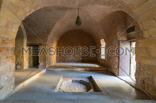 Hall at Mamluk era historic Prince Taz palace with vaulted stone bricks ceiling and marble fountain situated on the intersection of Saliba Street and Suyufiyya Street, Medieval Cairo, Egypt