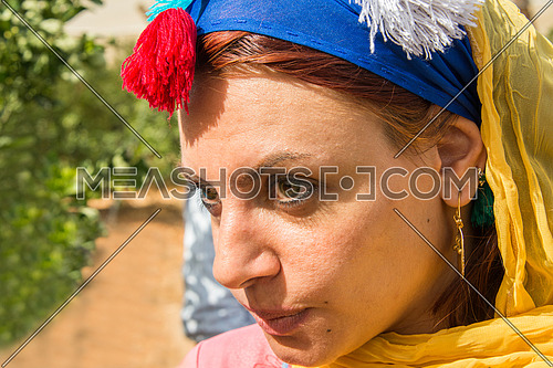 a close up shot on a female farmer face