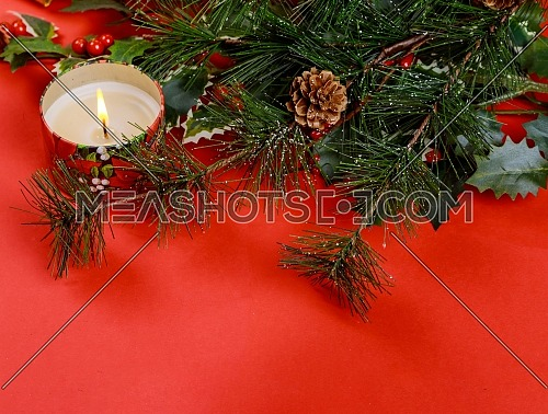 Family holiday, christmas red background with and christmas tree candles