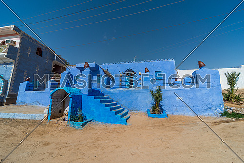 Long shot for a Nubian house painted with blue color at day