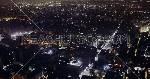 360 Drone shot over Cairo until reach The River Nile showing Bridges at night