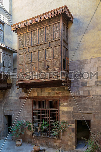 Facade of Zeinab Khatoun historic house with Mamluk era style oriel window covered by interleaved wooden grid (Mashrabiya), located near to Al-Azhar Mosque in Darb Al-Ahmar district, Old Cairo, Egypt