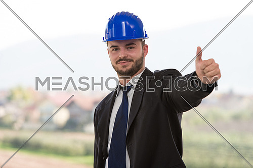Young Construction Worker Showing Thumbs Up