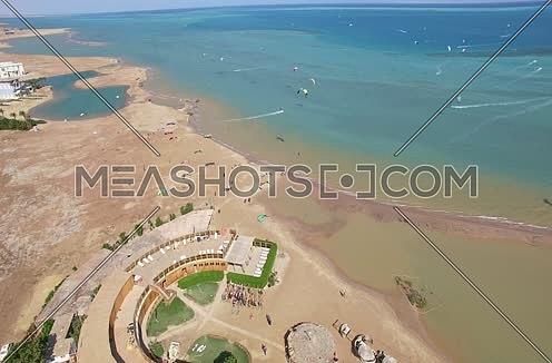 Drone shot flying above the red sea at Kite surfing  area at Day