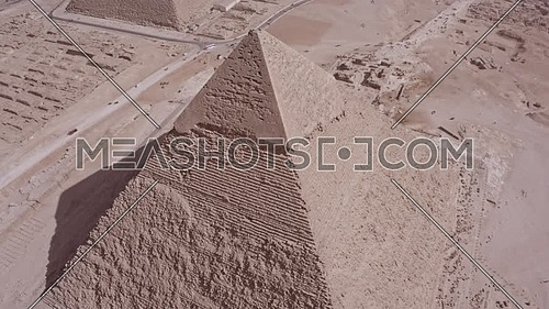 Fly over Shot Drone for the pyramid of khafre  showing The Great Pyramids of Kufu till Top shot over the pyramid of menkaure in background at day