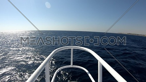 Long shot for the sea from boardside of boat at day
