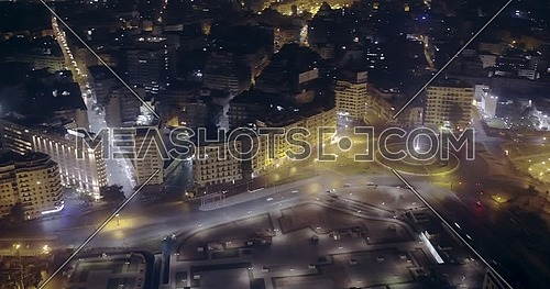 Drone shot fly around for Tahrir Square showing National Flag Pole in Cairo at night