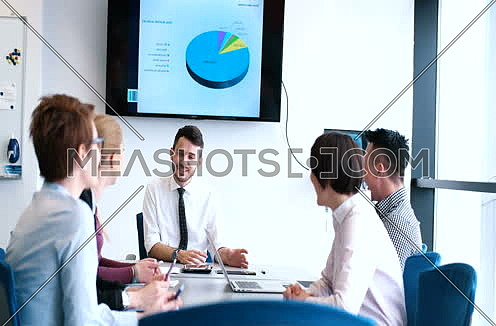Casual Business Team In A Meeting In A Light Modern Office