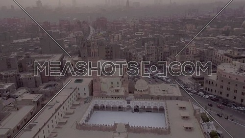 Fly Out Shot for Al-Azhar Mosque reveals Cairo City by dusk