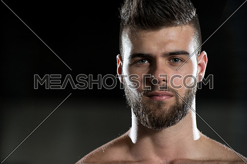 Portrait Of A Young Sporty Man In The Modern Gym With Exercise Equipment