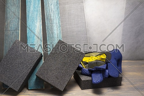 Various grinding tools - abrasive sponge, safety gloves and glasses, renovation, safety and health at work concept