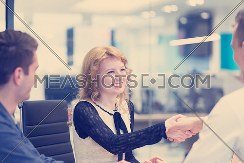 Business Partner Shake Hands on meetinig in modern office building
