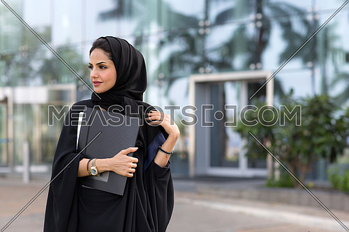 Student arab lady after her class