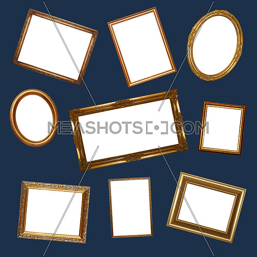 Pattern of many different empty baroque style golden picture frames over dark blue background