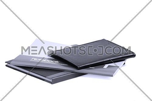 assorted notebooks flat piled on white background,blue filter