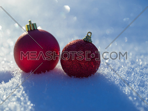 christmas balls tree decoration in fresh snow abstract background