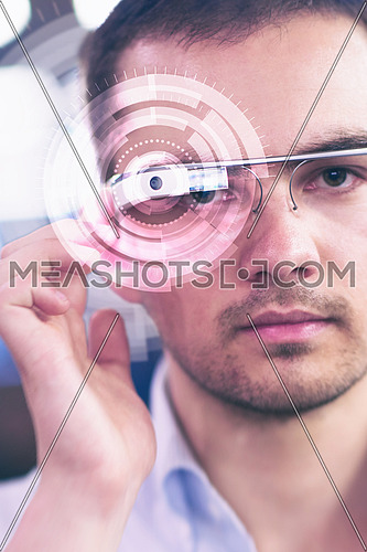 Picture of handsome programmer with futuristic glasses