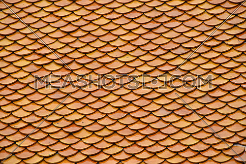 Golden brown orange color painted glazed traditional Asian antique vintage ceramic, roof tiling decoration