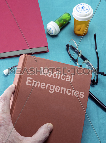 Doctor holds a medical emergency book in a hospital