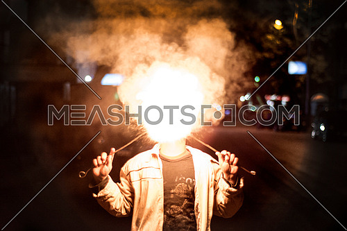 street circus fire boy throws flame to the camera
