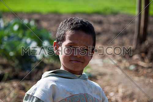 Farmer's son standing in the field