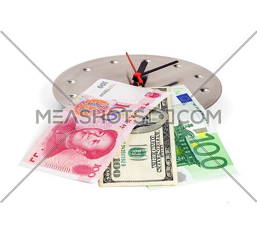 currency bills on a stainless steel clock clock isolated on white back ground