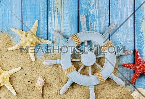 Top view star fish the sailor's captain's wheel on a blue wooden boards