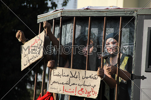 a symbolic prison  mockup during a protest