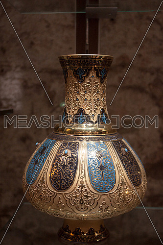 a golden and blue Vase
