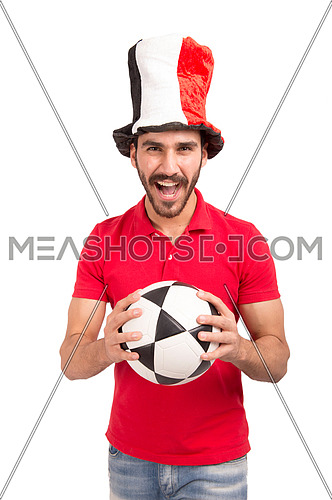 A young man encourages the Egyptian football team wearing a hat with the flag of Egypt