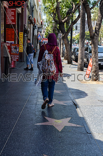 A muslim veiled girl walking on the Hollywood walk of fame