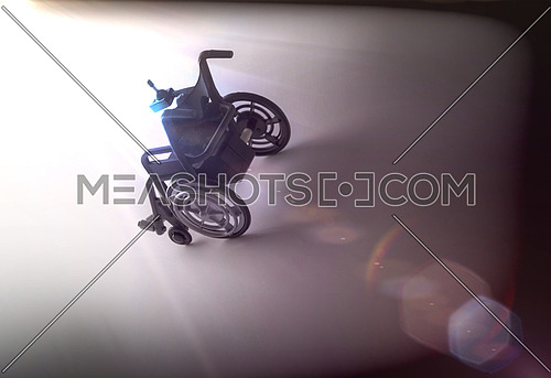 Wheelchair near the light in a way, conceptual image