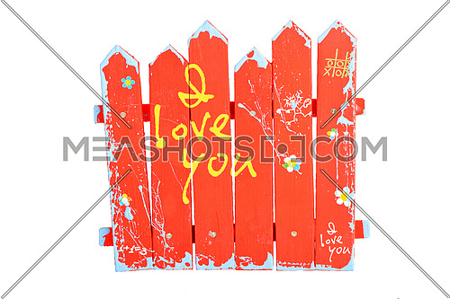 Red wooden souvenir handmade painted fence with yellow I love you words isolated on white