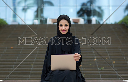 Arabic lady working in her laptop
