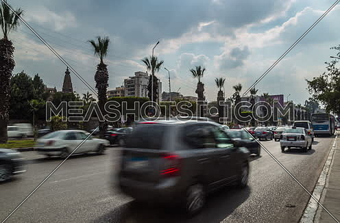 Zoom OUT Shot for traffic at Salah Salim Street showing Le Baron Palace in background at Daytime