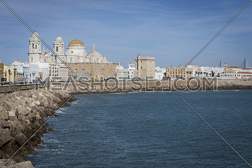 Cadiz, Spain - March 31: Panoramic view of the city on March, bordered by the Mediterranean sea and its Cathedral, called Catedral Nueva by locals, in the background, take in Cadiz, Andalusia, Spain