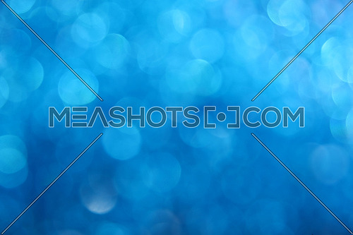 Winter night blue glitter bright magic fairy light circles Christmas abstract blur effect background