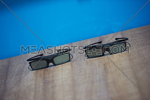 hi technology modern movie 3d glasses with blue background