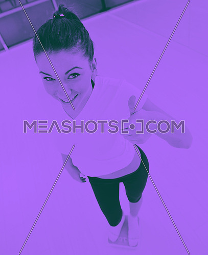 happy diet concept with young woman on pink scale at sport fitnes gym club duo tone
