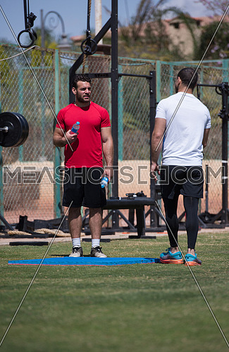 Portrait of a young middle eastern Athletic-built men in the external field of fitness which is preparing for exercise